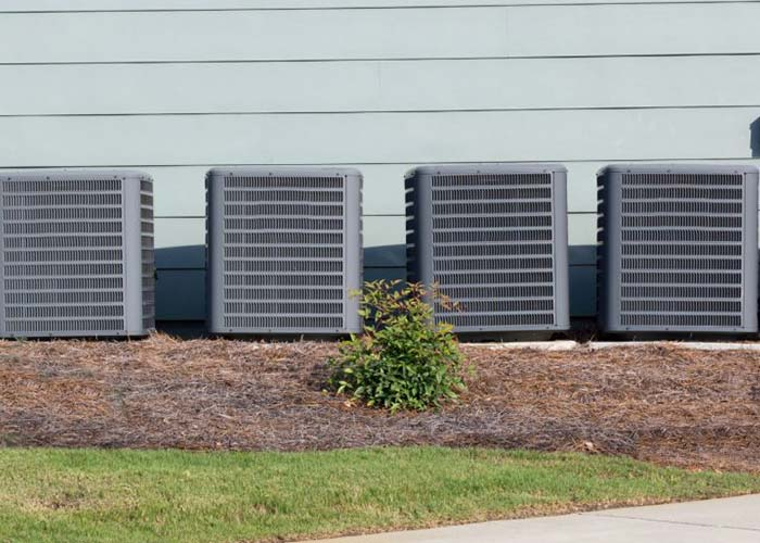 air conditioners at residential home in Austin, HVAC installation, replacement