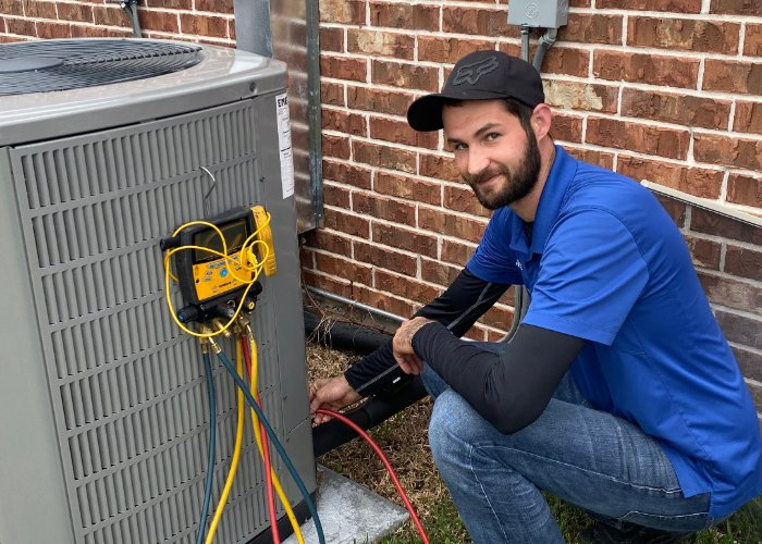 superior hvac austin technician repairing an air conditioning system